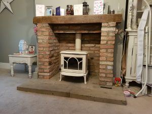 Jotul F100 installed in a brick fireplace