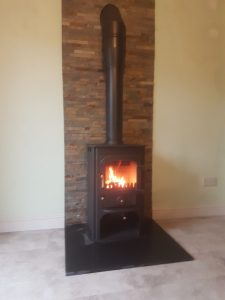 Clearview Solution 400 with twin wall flue and split face tiles behind