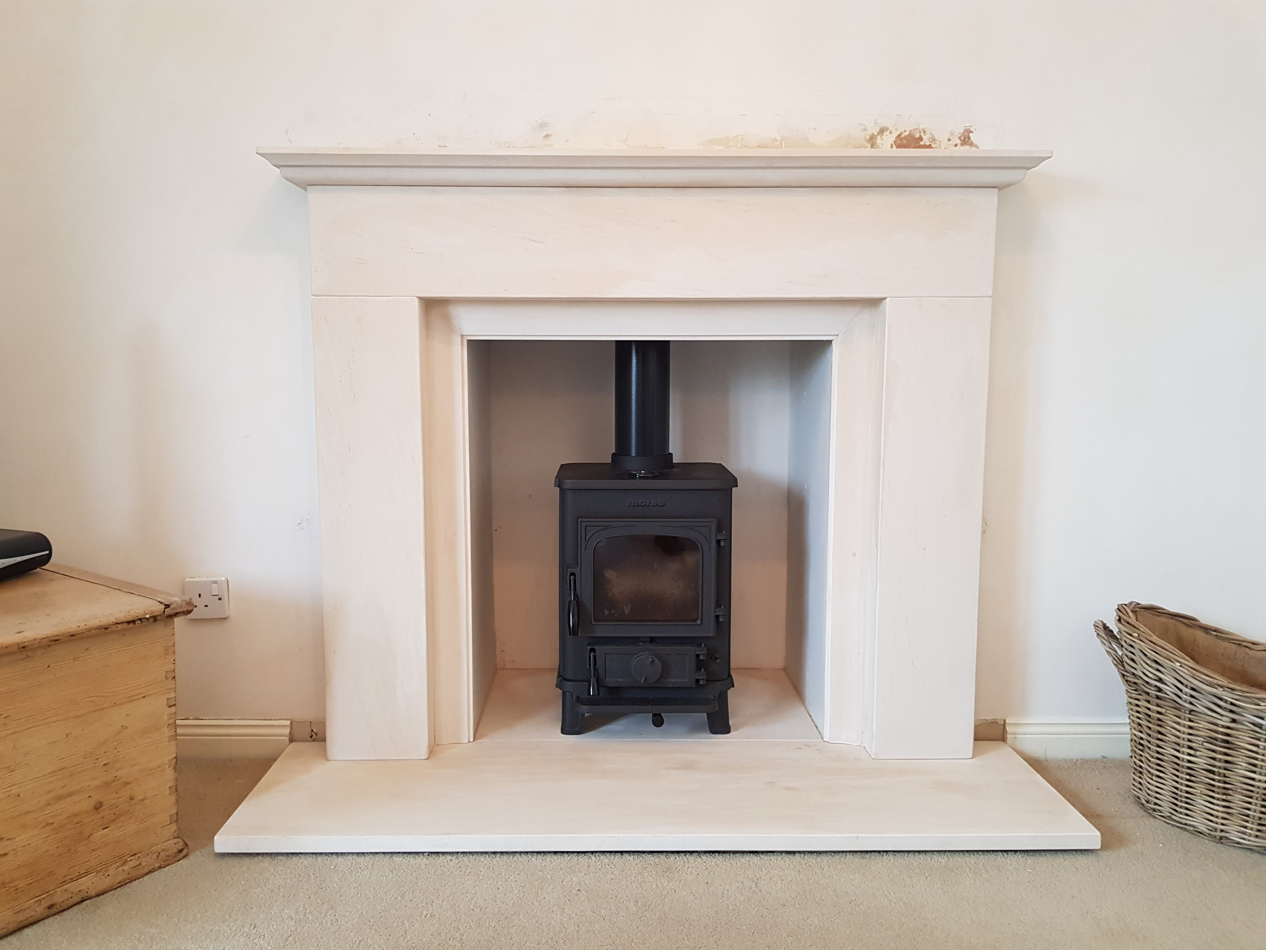 Morso Squirrel Stove installed in a limestone fireplace