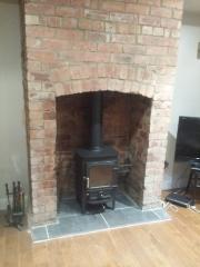 Pioneer in brick fireplace