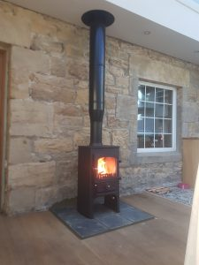 Clearview Pioneer 400P logstore stove with twinwall flue installed into a conservatory