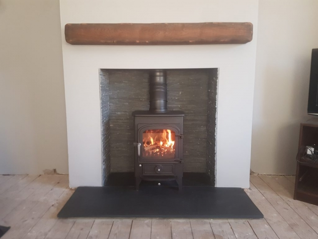 Clearview Pioneer Defra approved with slate hearth, split face tiles and oak beam