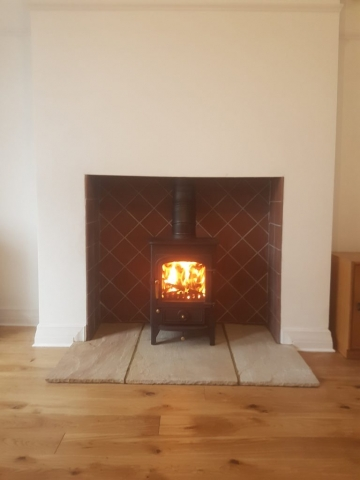 Clearview Pioneer Defra Approved with sandstone hearth and tiled fireplace