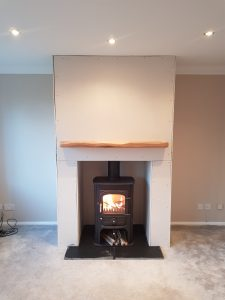Clearview Solution 400 Defra approved stove with twinwall flue with false chimney breast and oak beam